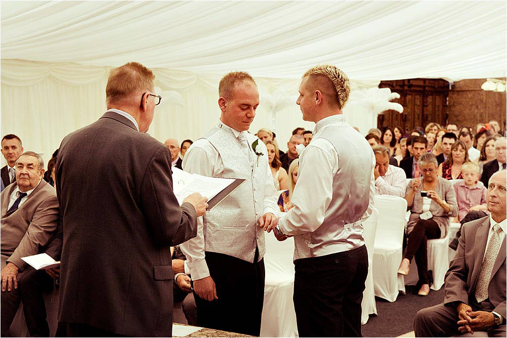 Adam and Ben exchange their vows in front of their wedding guests