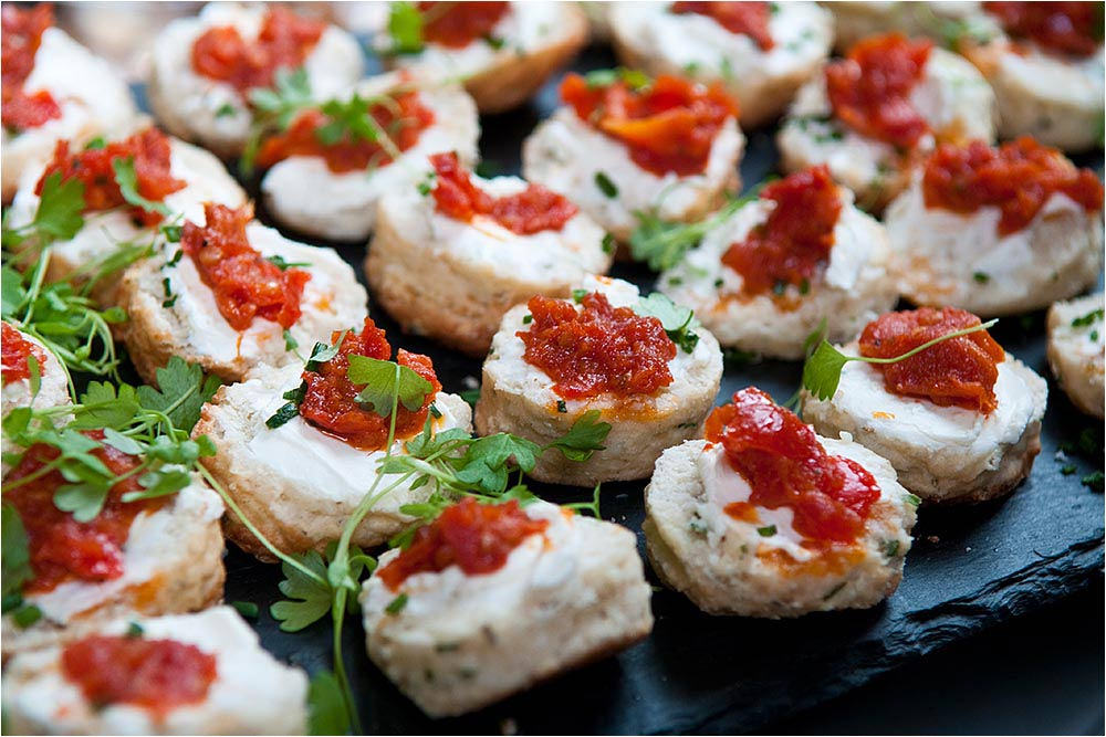 Tasty looking canapes on a slate platter