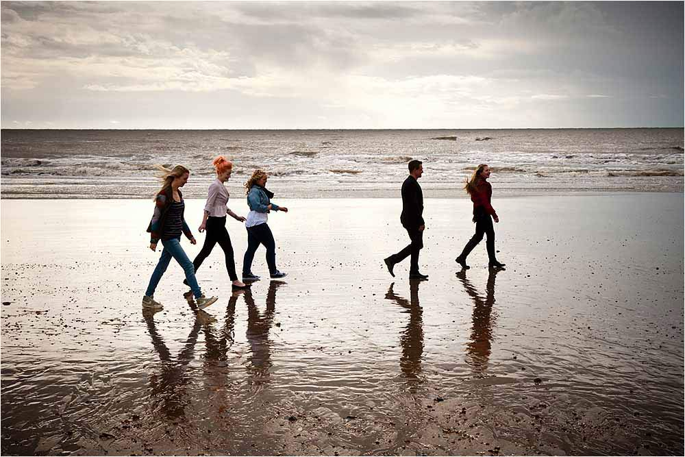Amy, Shane and the bridesmaids take an early morning stroll along Eastbourne Beach at low tide