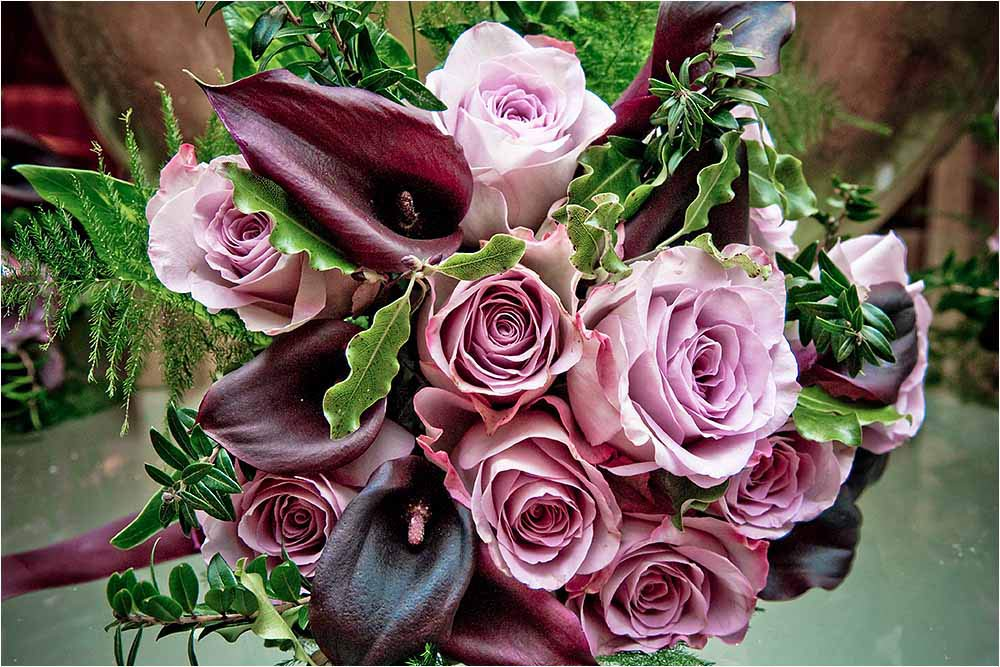 The beautiful dark pink rose wedding bouquet