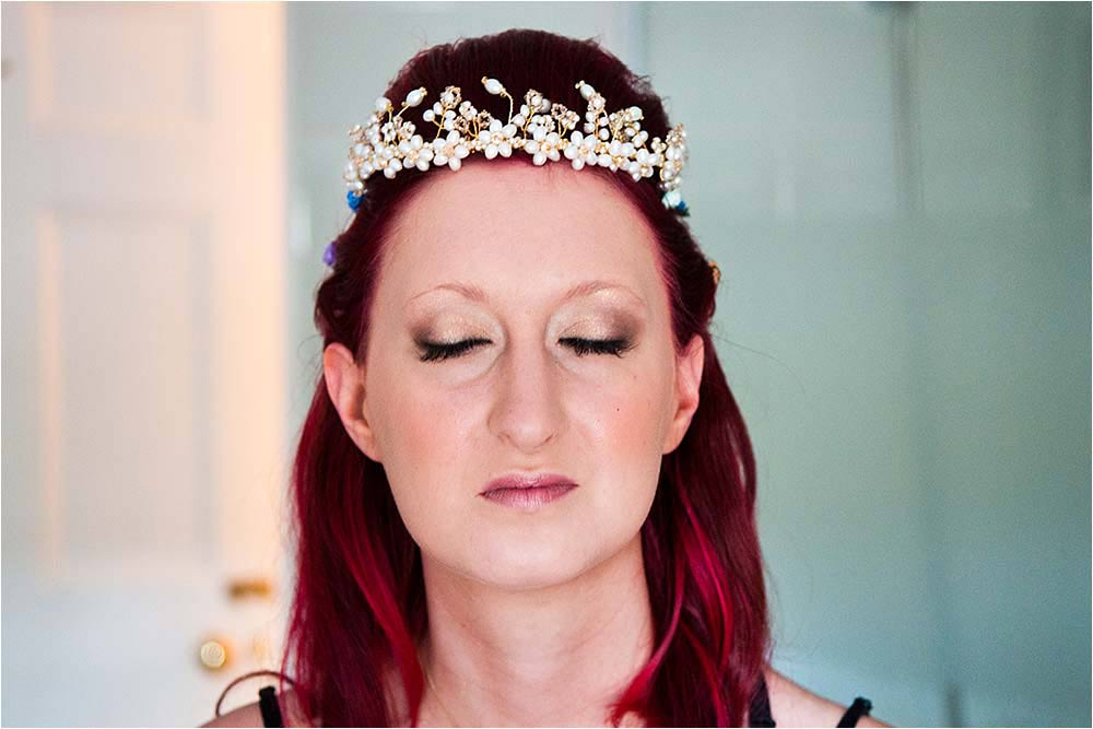 Bride seen just after her tiara has been positioned