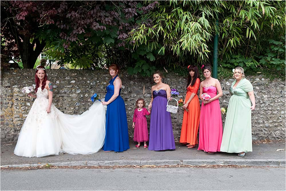 The bridal party walking along the street to Chalk Farm