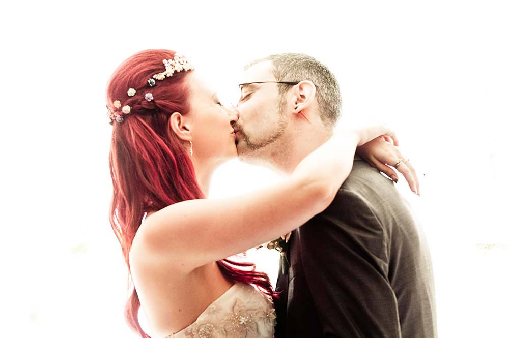 Georgia and Kevin have their first kiss as husband and wife
