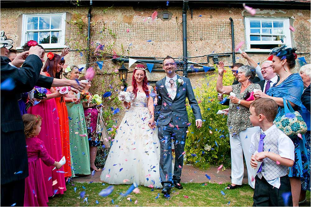 Guests throwing confetti in the garden