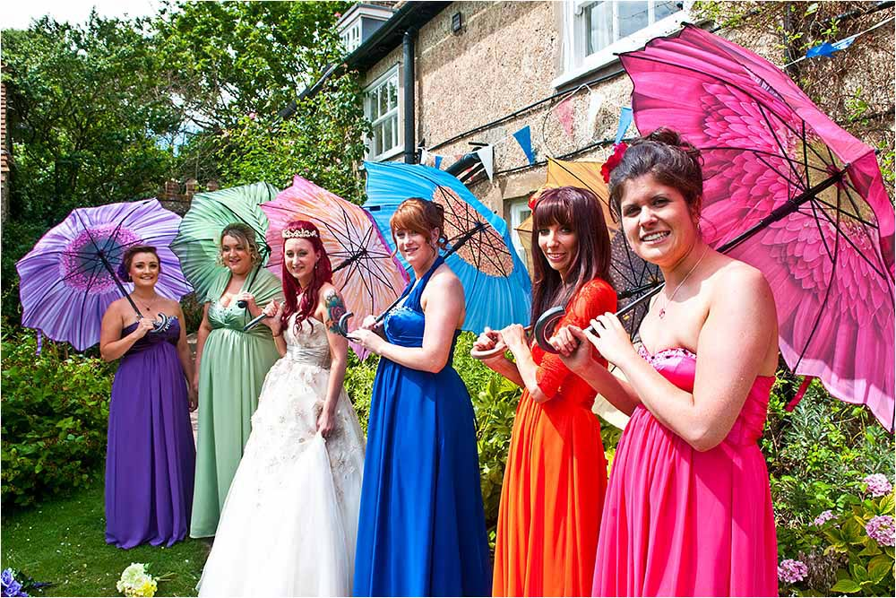 Bridesmaids in very colourful dresses