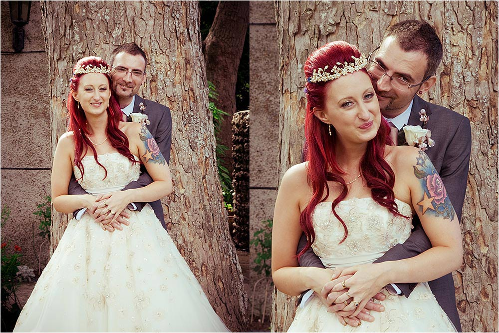 Bride and groom hugging by a tree