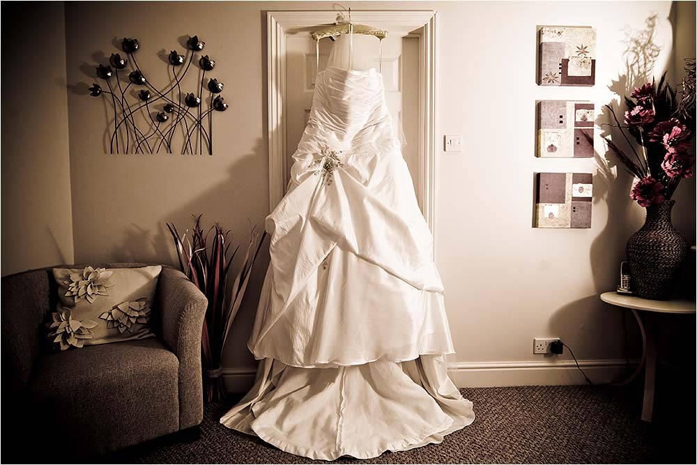 The wedding dress hanging in the hallway