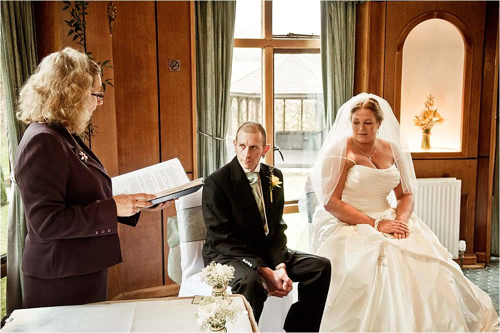The registrar with the bride and groom