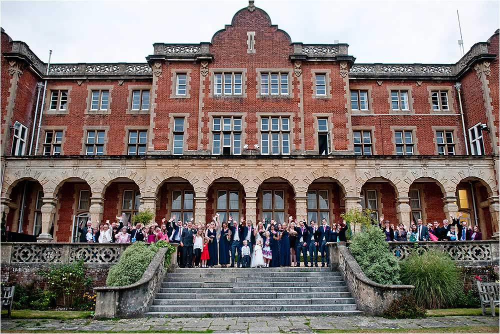 The entire wedding party on the terrace at Easthampstead Park