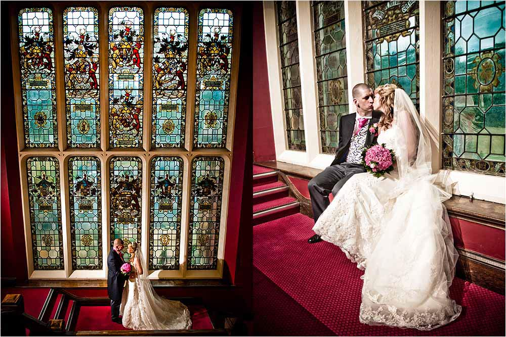 Rebecca and Mark by the beautiful stained glass windows