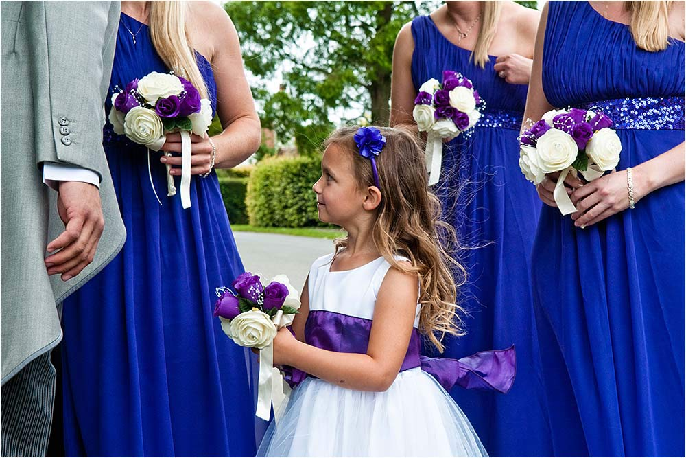 Bridesmaids and a flower girl outside the church