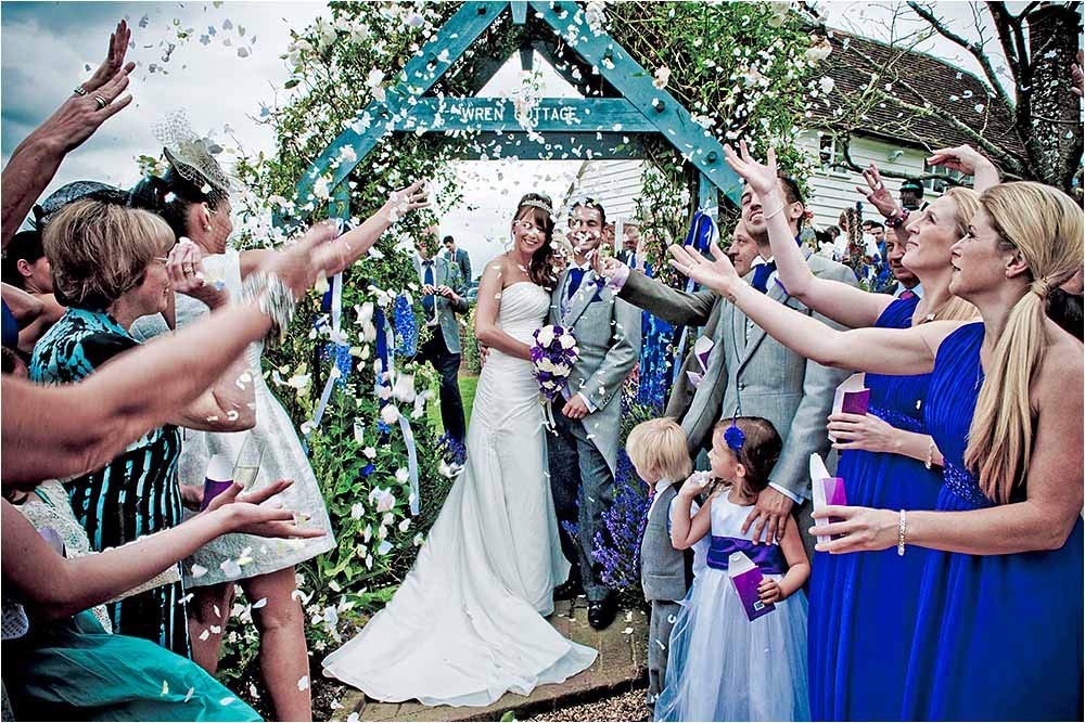 A fantastic storm of confetti over the bride and groom