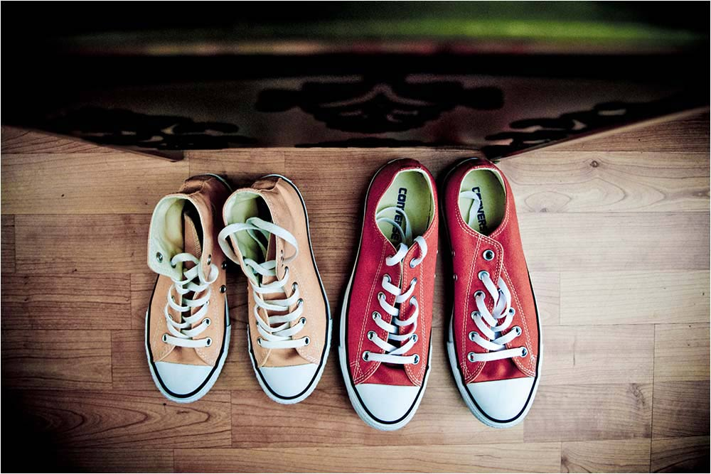 Two pairs of converse trainers used as wedding shoes