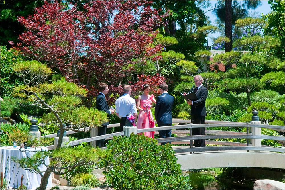 Angie and Tom on the bridge at the Japanese Garden during the wedding ceremony