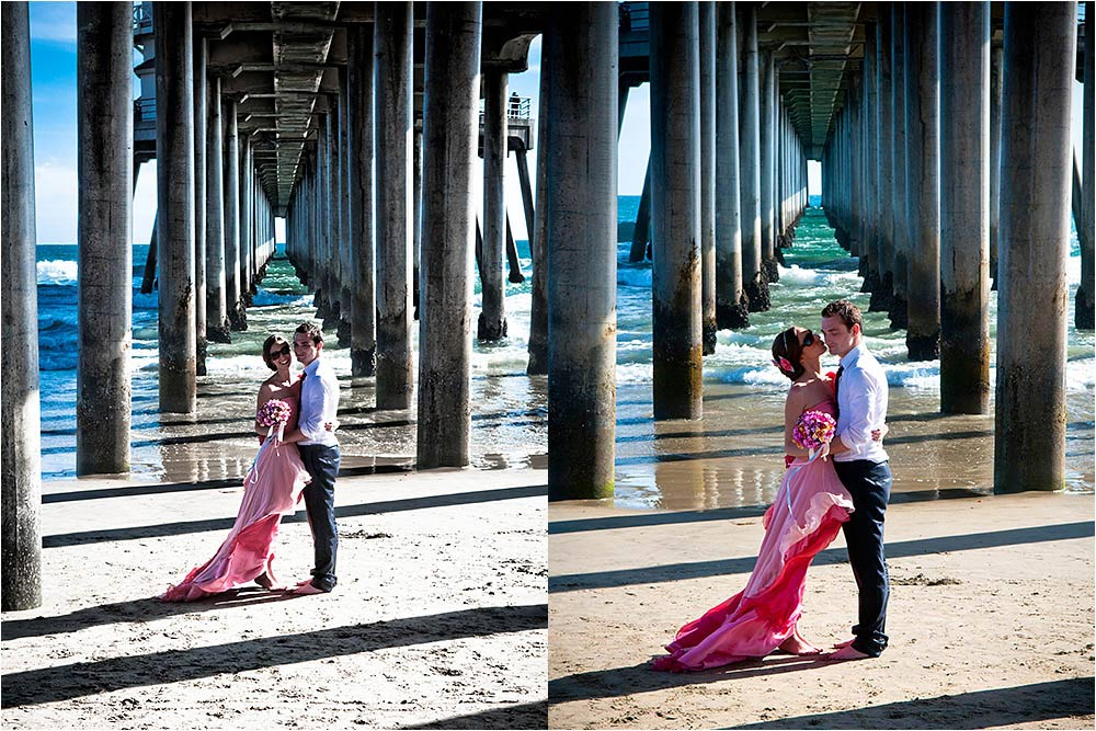Bride and groom posing under Huntington Pier in late afternoon sunlight