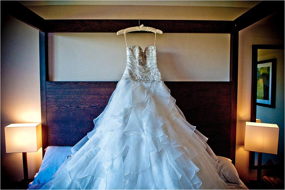 The wedding dress hanging over the bed at the Great Danes Hotel, Maidstone