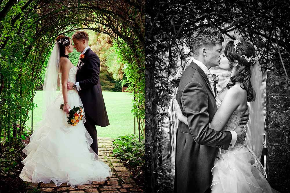Bride and groom kissing in the garden