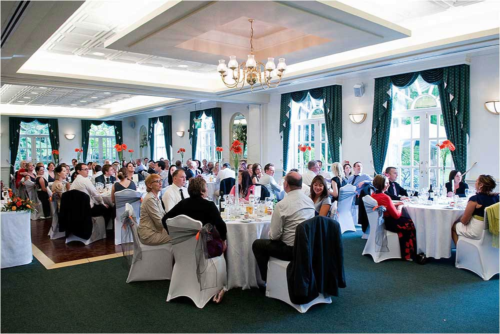 Image of the Orangery with guests seated for the wedding breakfast